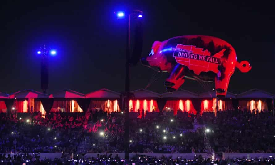 An inflatable pig carrying political slogans flies above the crowd at Empire Polo Club during Roger Waters' closing set on 9 October.