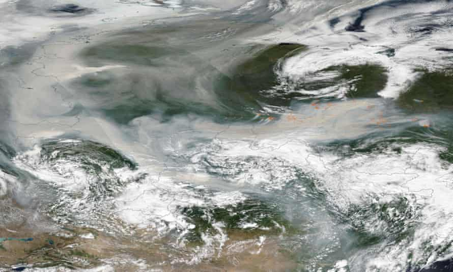 An image released by Nasa shows smoke from hundreds of forest fires covering most of Russia on 6 August