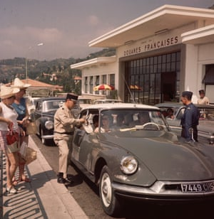 French customs officials check a car passing through the French, Italian border in 1975.