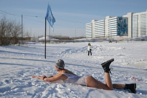Novosibirsk, Russia: An 'ice swimmer' takes her turn in a 24-hour session in a pit lakea. The event honours a second world war Soviet infantry soldier who blocked a German machine-gun with his body