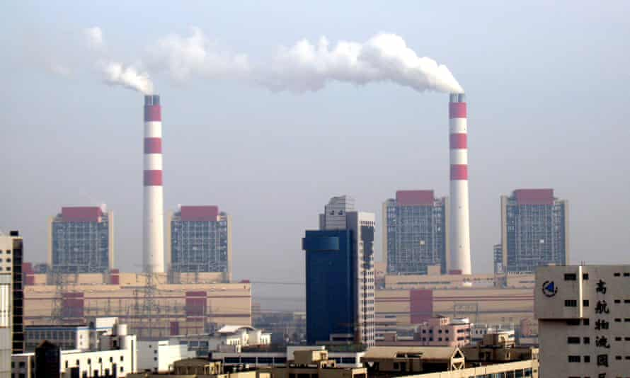 Smoke is emitted from chimneys at the Waigaoqiao coal-fired power plant in Pudong, Shanghai.