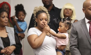 Tomika Miller, the wife of Rayshard Brooks, holds their daughter Memory during the family press conference on Monday in Atlanta.