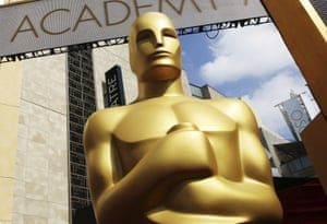 An Oscar statue appears outside the Dolby Theatre for the 87th Academy Awards in Los Angeles in 2015.