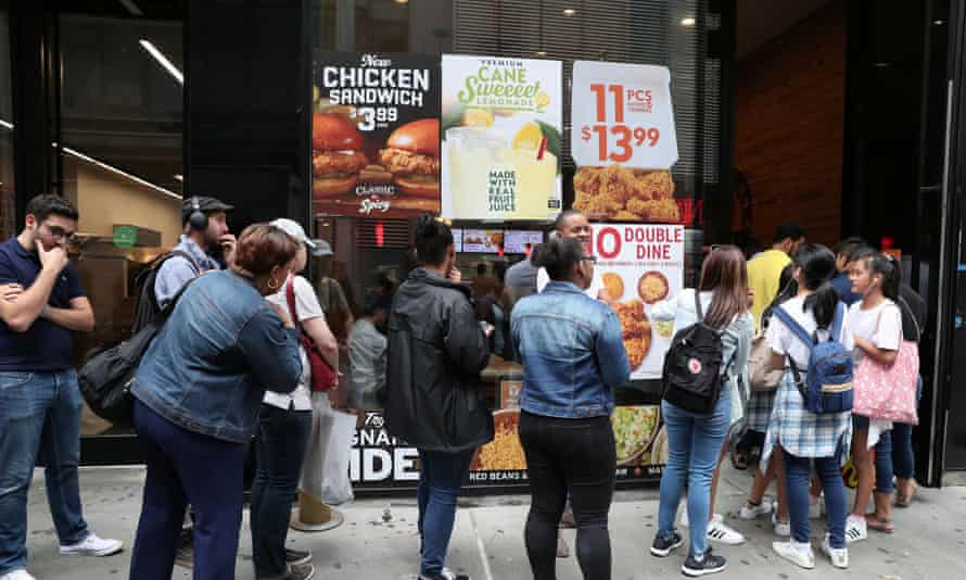 People wait in line outside a Popeyes restaurant in New York City, 23 August 2019.