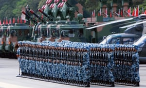 Soldiers of the Chinese People's Liberation Army garrison on parade at Shek Kong barracks in Hong Kong.