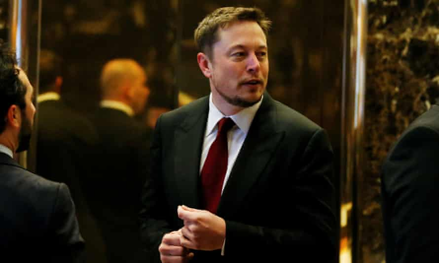 Elon Musk enters the lobby of Trump Tower in January