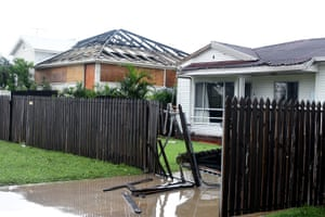 The roof of one house in Bowen can be seen in the neighbour's yard