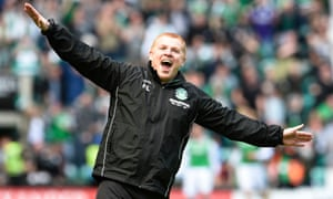 Hibernian manager Neil Lennon celebrates in front of the Rangers fans.