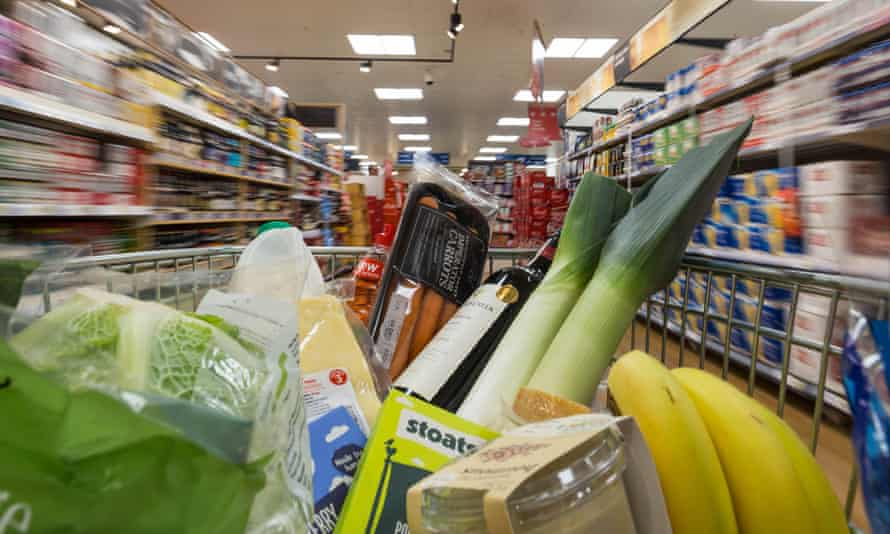 a supermarket trolley full of food and drink