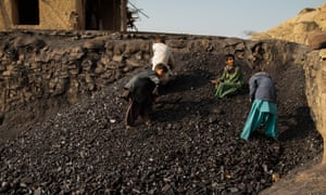 Child labourers sorting coal.
