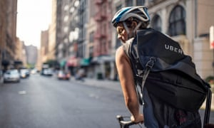 An Uber delivery person on a bike