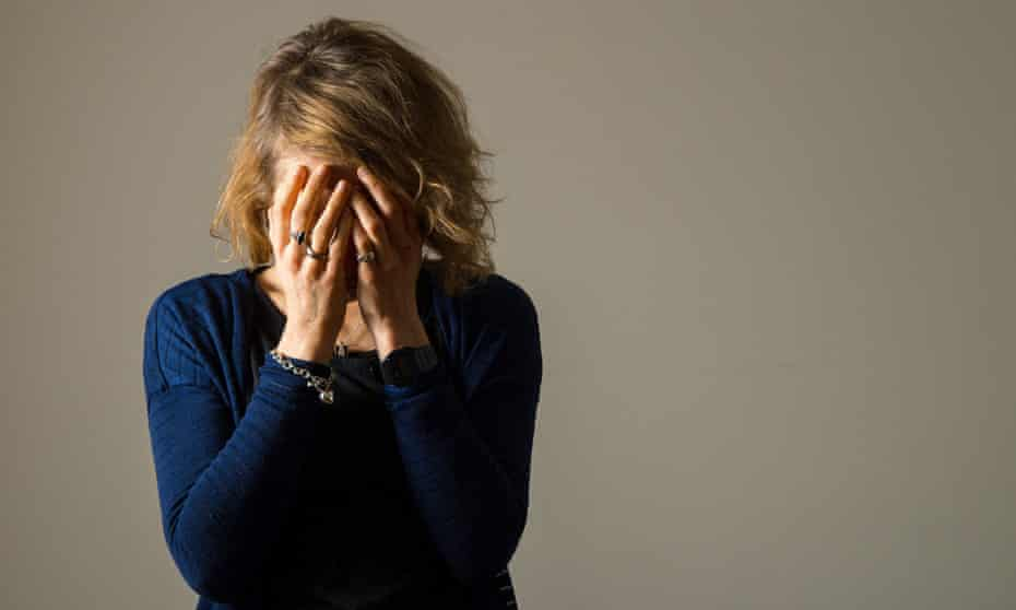 Coronavirus - Mon Mar 22, 2020PICTURE POSED BY MODEL File photo dated 09/03/15 of a woman with her head in her hands. T
