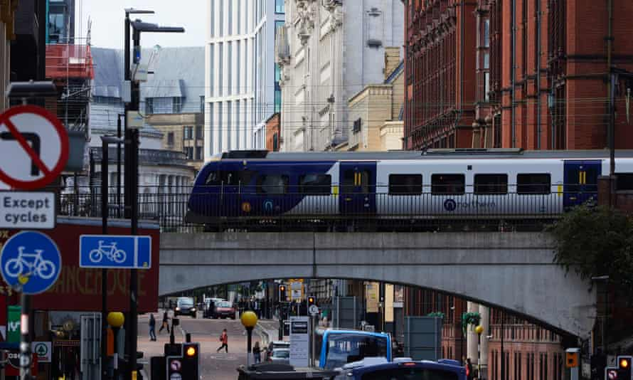A Northern Rail train passes over Oxford Road in Manchester.