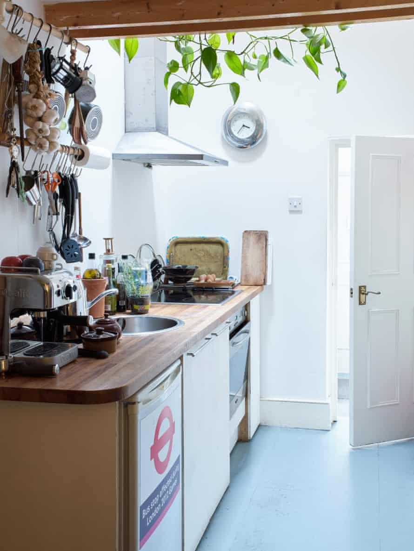 His tiny kitchen.