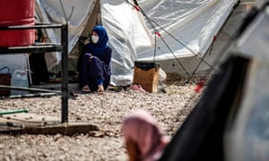 Women captured after the fall of Islamic State in Syria outside tents at al-Hol camp.