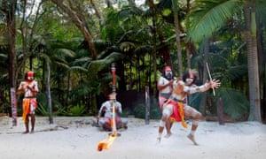 Group of Yugambeh Aboriginal warriors dance during Aboriginal culture show in Queensland, Australia