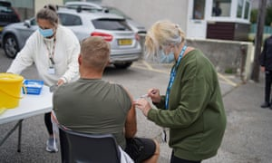 A member of the public receives a Pfizer Covid vaccination at an NHS walk-up vaccination unit in the village of Summercourt, near Newquay, Cornwall, United Kingdom.
