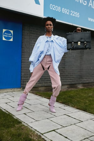 Shirt, £229, trousers, £538, and heels, £1,119, by Y/Project (yproject.fr) . Belt, £1,215, by Chanel (chanel.com). Earrings, £350, by All Blues (allblues.se). Case, stylist's own