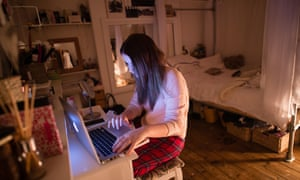 A teenage girl on her laptop
