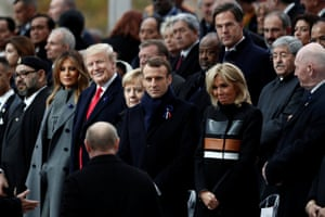 The Russian president, Vladimir Putin, takes his place with the French president, Emmanuel Macron, and first lady Brigitte, the German chancellor, Angela Merkel, the US president, Donald Trump, and first lady Melania, at the Arc de Triomphe