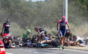 Riders and their bicycles fill the road after the crash