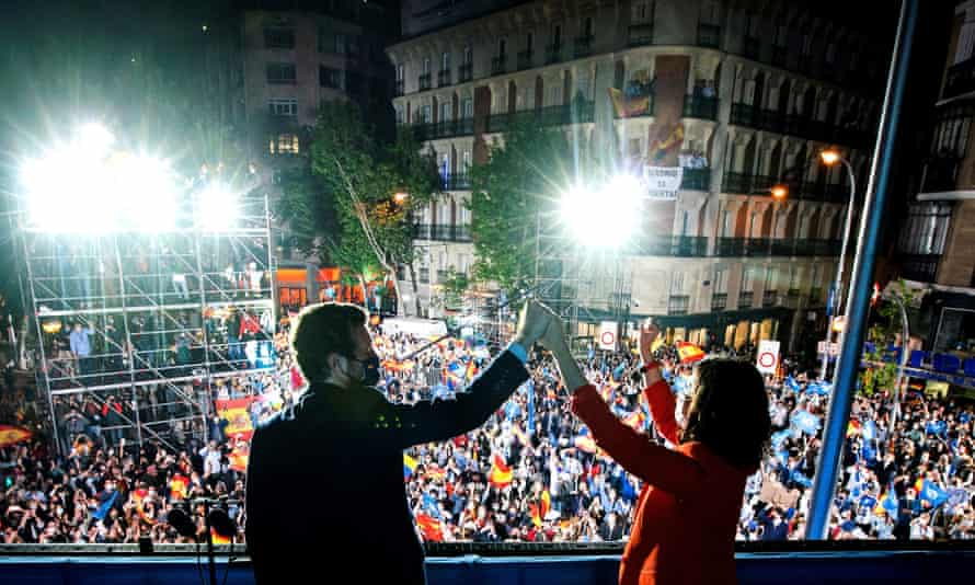 The People's party leader, Isabel Díaz Ayuso, with the party's national leader, Pablo Casado, as they celebrate the results at the party's headquarters in Madrid on Tuesday evening.