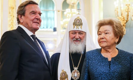 Gerhard Schröder, Patriarch Kirill of Moscow and All Russia, and Naina Yeltsina, the widow of Boris Yeltsin.