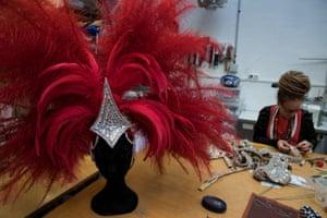 A dressmaker fixes a costume