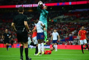 David de Gea goes up for a high ball with substitute Danny Welbeck beneath him.