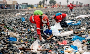Groups of volunteers clean up plastic waste on a beach in Lima, during the World Environment Day on 5 June