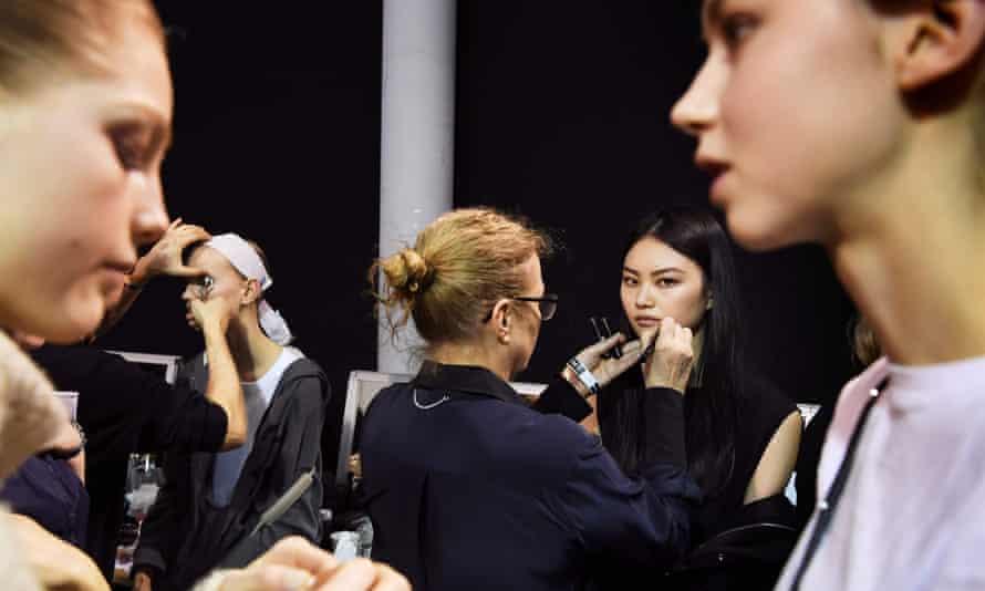 Models getting ready at Paris fashion week.