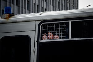 A supporter of Ivan Safronov, a former journalist and aide to the head of Russia's space agency Roscosmos, looks out from inside a police bus in Moscow