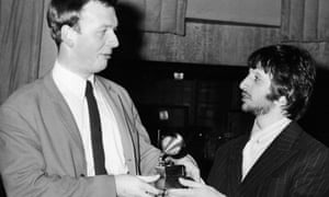 Ringo Starr gives Geoff Emerick his Grammy award for best engineered recording, 8 March 1968.