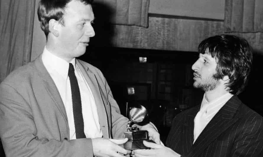Geoff Emerick, left, accepting a Grammy award from the Beatles' drummer, Ringo Starr, in 1968.