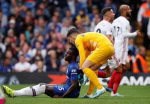 Chelsea's Kurt Zouma is consoled by teammate Kepa Arrizabalaga after scoring an own goal.