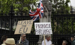 Brexit supporters holds placards as they protest outside the Houses of Parliament