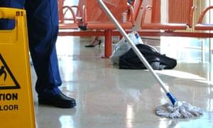 Hospital cleaner mopping floor