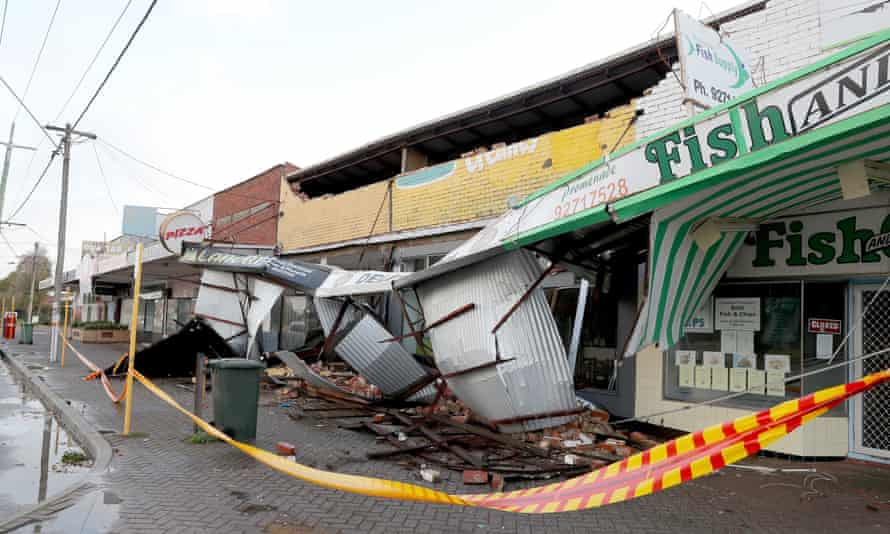 Debris covers the pavement after strong winds damaged shopfronts in Perth on Monday.