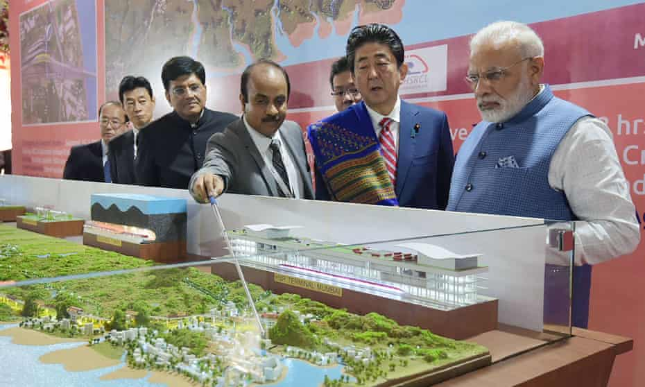Narendra Modi and Shinzō Abe look at a railway station model at a ground-breaking ceremony for the Mumbai-Ahmedabad high speed rail project in Ahmedabad.