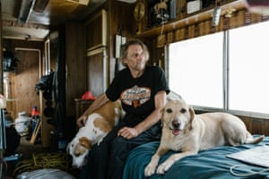 Chris Eakin with his dogs Mimi, left, and Blondie, right, inside his RV parked on Toland Avenue in San Francisco, California.