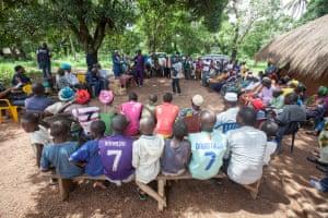 Dr Sakoba Keita, coordinator of the Guinean Ebola response, speaks to local media during a village meeting on Ebola