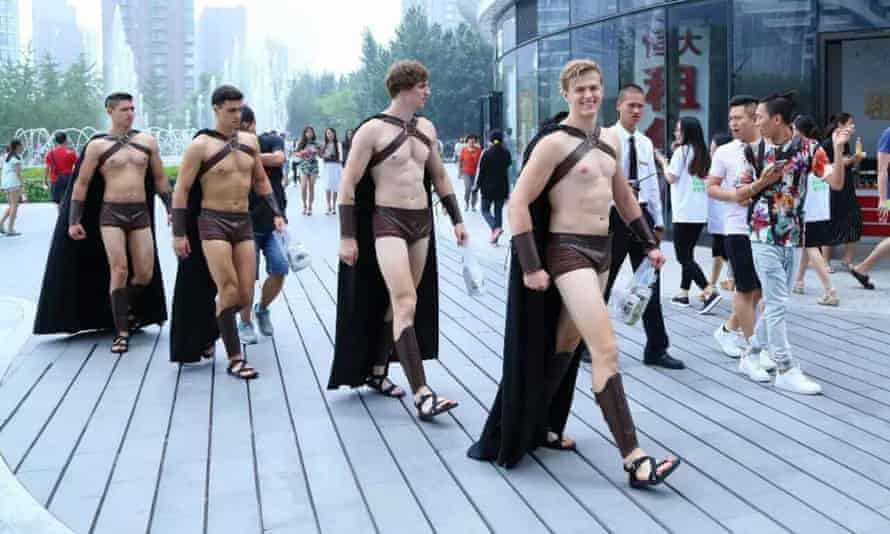Men dressed as Spartan warriors to promote a salad eatery.