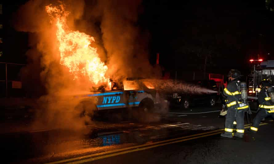 Firefighters put out a fire on a SUV of New York police department in the Brooklyn borough of New York.