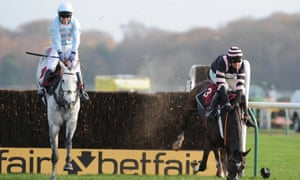 Activial clears the final fence as the unharmed River Wylde, right, falls at Haydock on Betfair Chase day last year.