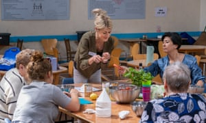 Vicky Gould, nutrition and dietetics lecturer at Cardiff Metropolitan University helps with cooking at a refugee welcome centre.