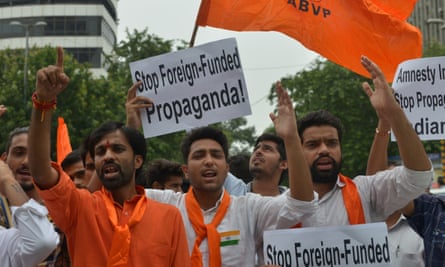 Demonstrators protest against Amnesty's involvement in an event held in disputed Indian Kashmir, which led to sedition charges against the NGO.