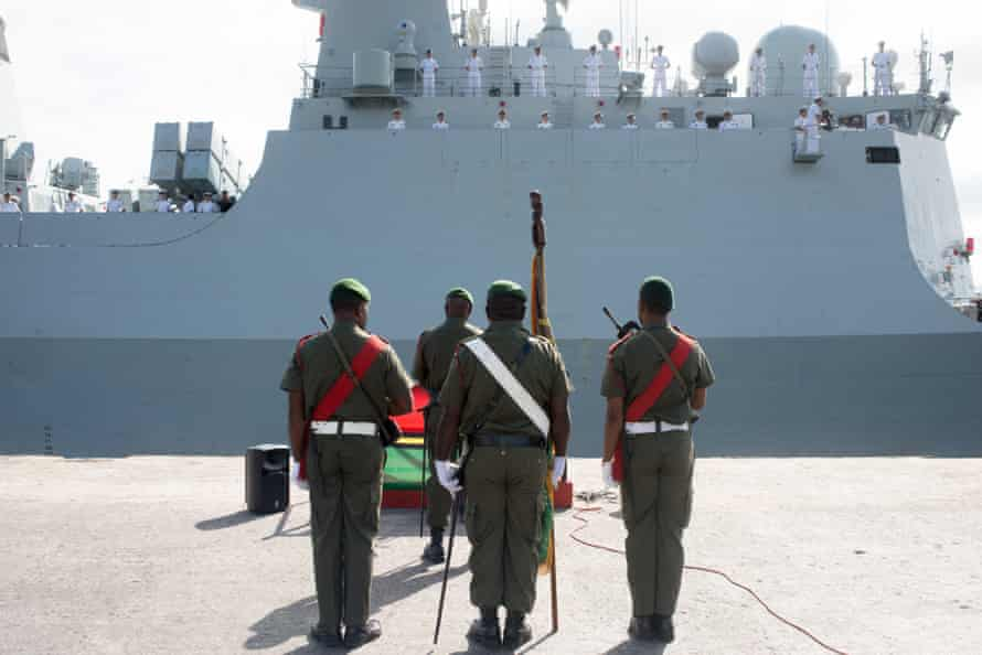 A Vanuatu Mobile Force honour guard stands in front of a People's Liberation Army of China navy frigate on a four-day friendly visit to Vanuatu.