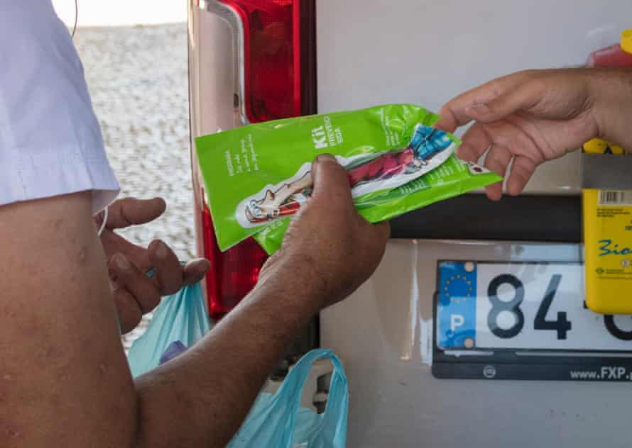 A man receives clean syringes after being given methadone at a clinic in Lisbon.