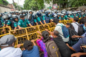 Students try to remove a police barricade in Dhaka, Bangladesh