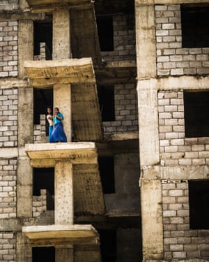 Two girls play in the half-finished Koye estate.